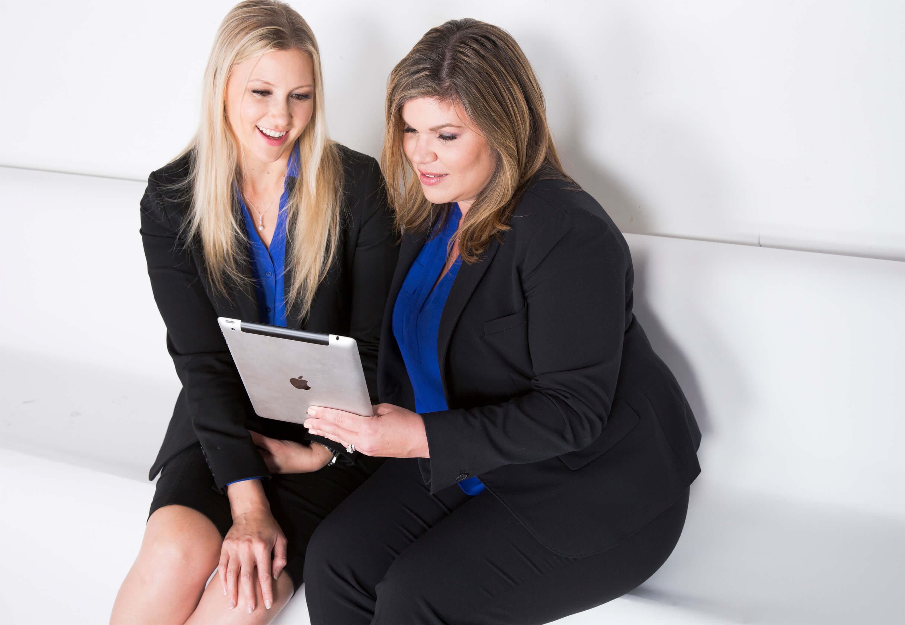 Cindy Hackler and Michelle Jorden sitting at an employment law firm defending businesses