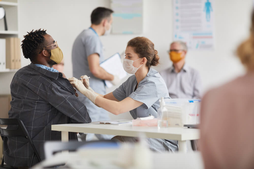 Man getting vaccinated in workplace