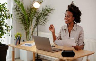 Happy black employee with employee benefits